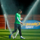 Keiren Westwood walks through the sprinkler system at Fota Island. Photo: David Maher/Sportsfile