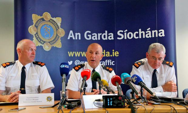 From left: Superintendent Finbarr Murphy of Ballymun garda station, Deputy Commissioner John Twomey and Superintendent Daniel Flavin of Mountjoy station speaking at the press briefing yesterday Photo: Colin Keegan, Collins Dublin