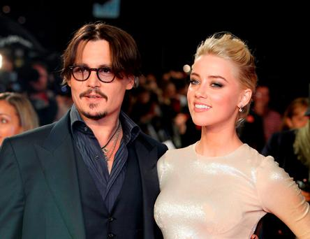 Johnny Depp and Amber Heard at a premiere of 'The Rum Diaries' in 2011 (AP)