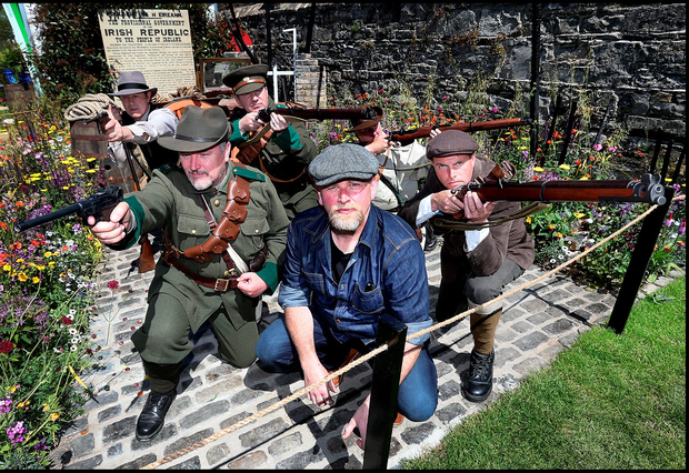 Designer Fiann Ó Nualláin with Joe O'Connor, Tola Collier, William Brennan, Steve Carey and Alan Battersby at the 'Bullets and Boiled Sweets - 1916 Commemoration Garden' at Bloom Photo: Steve Humphreys