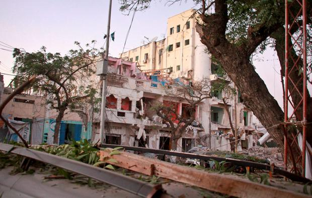 The scene of a bomb attack on an hotel in Mogadishu, Somalia Wednesday, June 1, 2016. (AP Photo/Farah Abdi Warsameh)