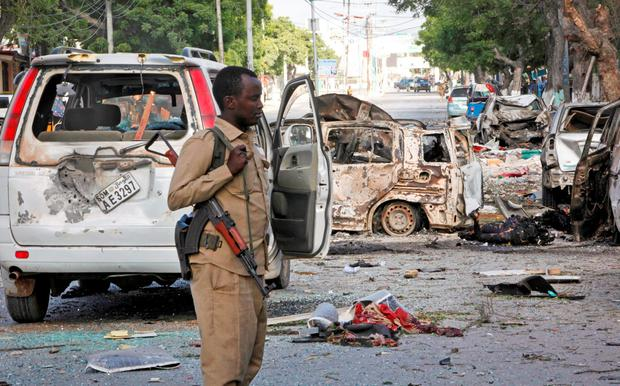 A Somali policeman patrols at the scene after a bomb attack on Ambassador Hotel in Mogadishu, Somalia Thursday, June 2, 2016. (AP Photo/Farah Abdi Warsameh)