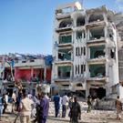 Security forces examine the scene after a bomb attack on Ambassador Hotel in Mogadishu, Somalia, Thursday, June 2, 2016. (AP Photo/Farah Abdi Warsameh)