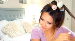Beauty blogger Tina Lee shows how to use the balloons in a YouTube video
