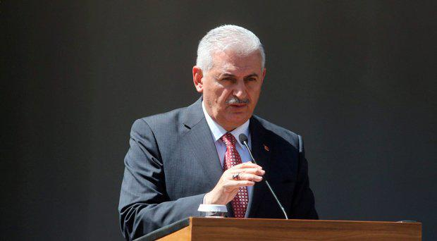 Turkish Prime Minister Binali Yildirim speaks to the media during a visit in the Turkish-administered northern part of Cyprus, June 1, 2016