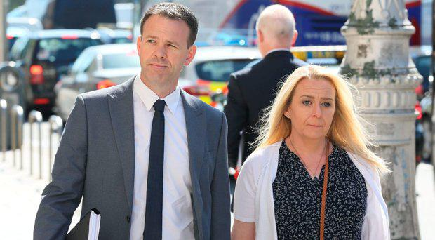 Sinn Fein TD John Brady and his wife, Gayle Ui Bhradaigh pictured leaving the Four Courts after the opening day of a High Court action