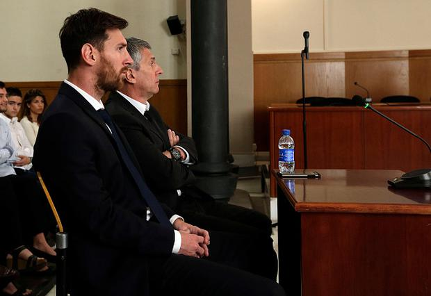Lionel Messi of FC Barcelona and his father Jorge Horacio Messi at an earlier court hearing Photo by Alberto Estevez - Pool/Getty Images