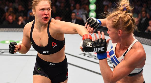 Ronda Rousey in action against Holly in 2015 - her last appearance in the octagon