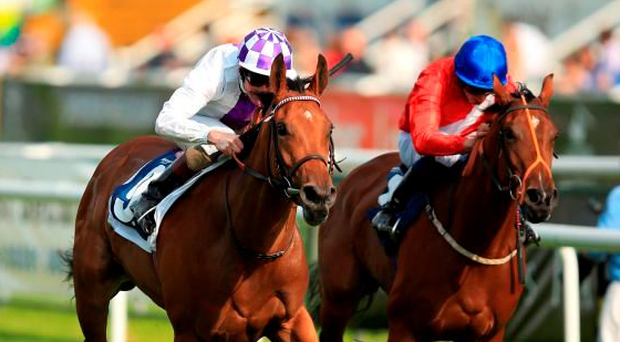 Turret Rocks and Kevin Manning (left), here beating Marenko at Doncaster last September, are fancied to claim today's Oaks at Epsom for Jim Bolger. Photo: Mike Egerton/PA Wire