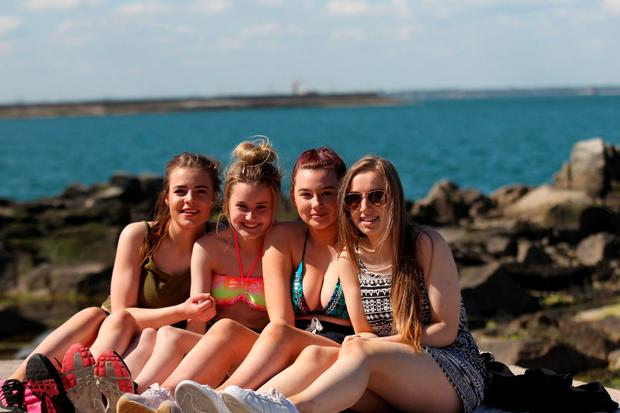 Alannah Dunster, Nicole Redmond, Alisha White and Kayleigh Perry enjoying the good weather at the Forty Foot, Sandycove , Dublin this afternoon Pic Stephen Collins/Collins Photos