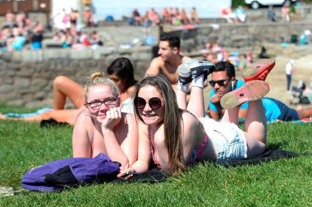 Leah Molloy and Ciara Webster enjoying the good weather at the Forty Foot, Sandycove this afternoon Pic Stephen Collins/Collins Photos