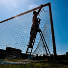 Cork City groundsman Pat O'Sullivan ties up the goalnets ahead of Tuesday's historic friendly at Turner's Cross between Ireland and Georgia. Photo: David Maher/Sportsfile