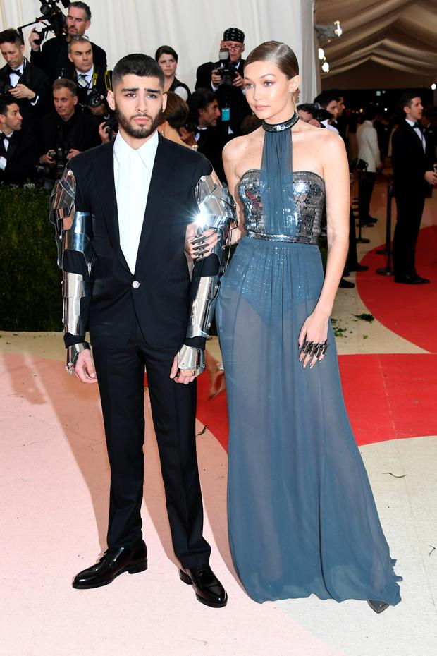 Gigi Hadid (L) and Zayn Malik attend the