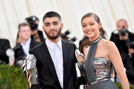 Zayn Malik (L) and Gigi Hadid attend the