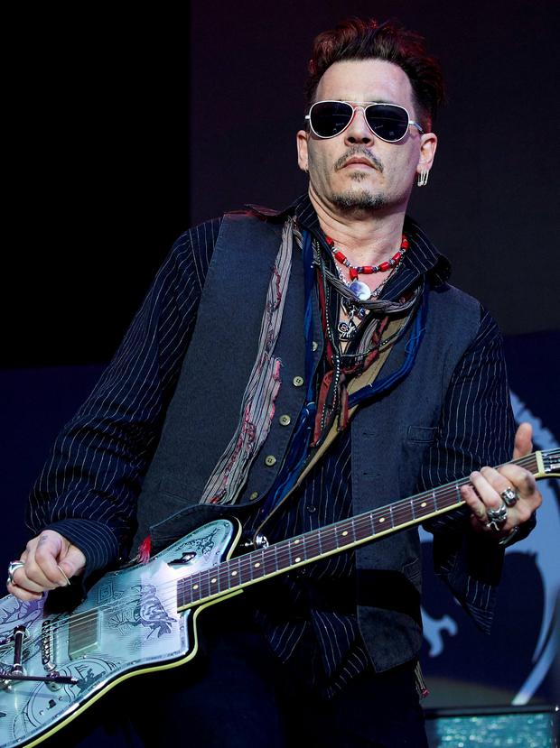 Johnny Depp performs with his band