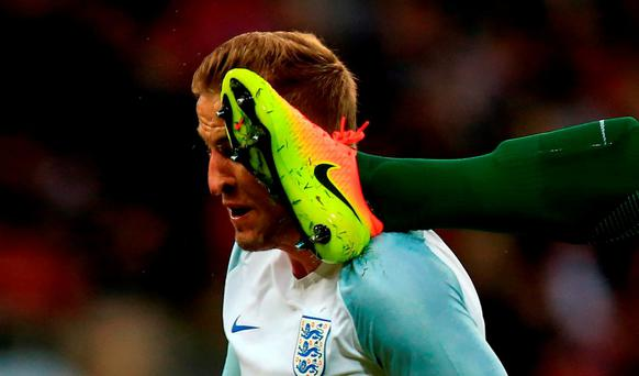 Portugal's Bruno Alves (right) commits a foul on England's Harry Kane for which he is sent-off during an International Friendly at Wembley last night