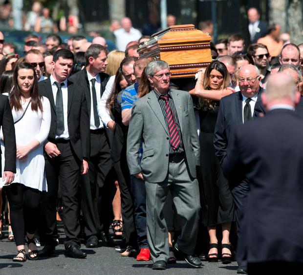 Mourners at the funeral of Gareth Hutch at the Holy Family Church in Aughrim Street in Dublin