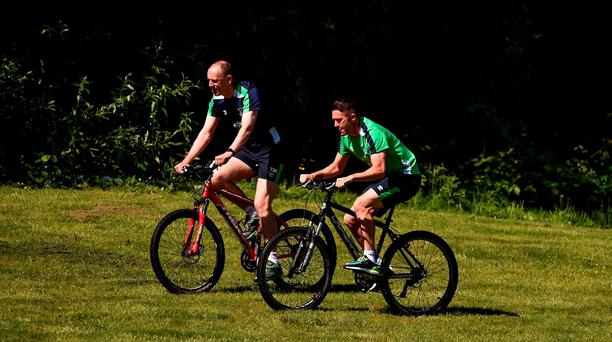 Robbie Keane of Republic of Ireland on a bicycle alongside team physio Tony McCarthy during squad training in Fota Island Resort, Fota Island, Cork. Photo by David Maher/Sportsfile