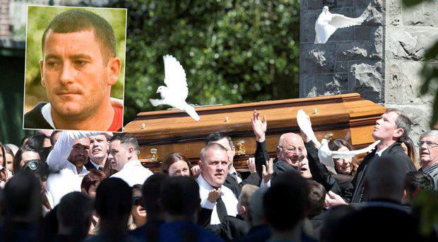 Mourners at the funeral of Gareth Hutch, inset, as doves are released