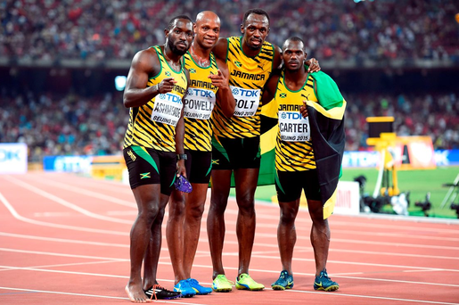 Jamaica's 4x100m gold medal winning relay team of Usain Bolt (third left), Asafa Powell (second left), Nickel Ashmeade and Nesta Carter (right) during day eight of the IAAF World Championships at the Beijing National Stadium, China. PRESS ASSOCIATION Photo.