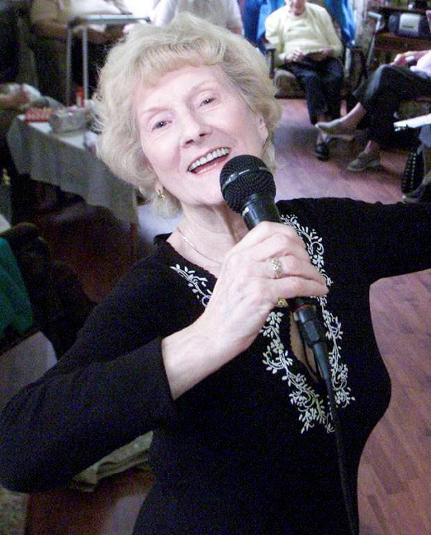 Performer: Violet Morrison, mum of singer Van Morrison, entertains members of the Age Concern Day Centre at North Road, Belfast, in 2003