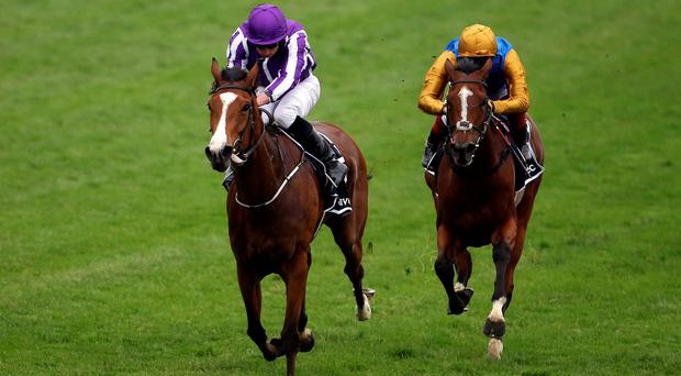 Minding ridden by Ryan Moore wins the Investec Oaks at Epsom ahead of Architecture and Frankie Dettori who finished second Photo credit: Steve Parsons/PA Wire.