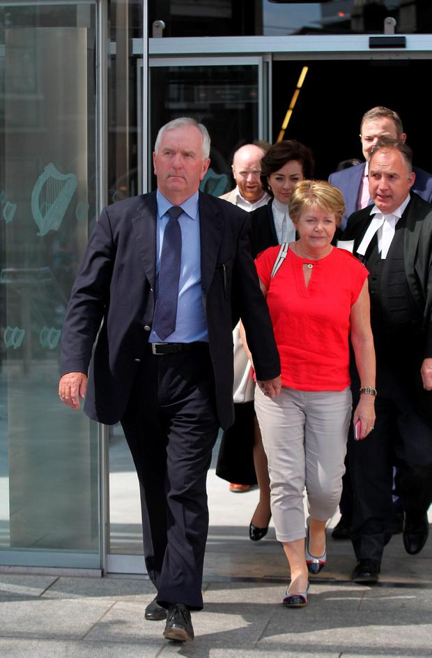 Former ILP finance chief Peter Fitzpatrick (left) leaves Dublin Circuit Criminal Court after being acquitted. Photo: Collins