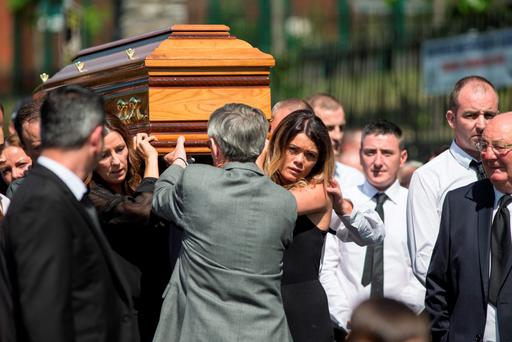 The coffin of Gareth Hutch is carried from the Holy Family Church in Dublin yesterday (Picture: Mark Condren)