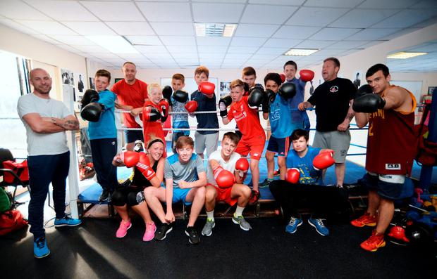 Coaches including Noel Fitzgerald and Richie Fox with the boxers of Ballybough Boxing Club Photo: Caroline Quinn