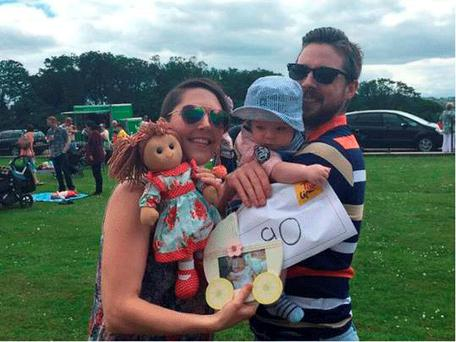 Claire and Kristofer Cray with son Archie and Matilda doll
