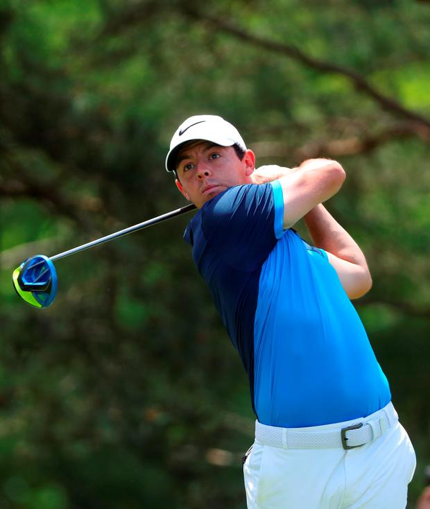 Rory McIlroy watches his tee shot on the second hole at The Memorial Tournament yesterday. Photo Credit: Sam Greenwood/Getty Images