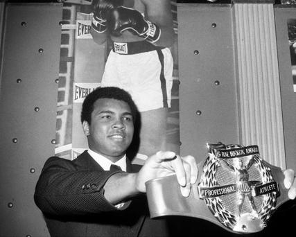 The Champion Gets Belted, Muhammad Ali admires the Hickok Belt at Waldorf Astoria, where he was named Professional Athlete of 1974. He got 25 1/2 more votes than Hank Aaron. While relishing past glories, Ali announced future plans: he'll fight Chuck Wepner in Cleveland March 24. (Photo By: Dan Farrell/NY Daily News via Getty Images)