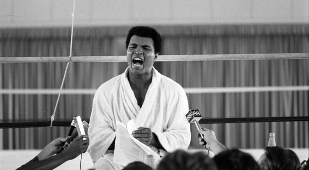 ZAIRE - OCTOBER 26: Boxing: WBC/ WBA World Heavyweight Title Preview: Muhammad Ali during interview with press while training before fight vs George Foreman at the Salle de Congres in the presidential complex outside of Kinshasa. N'Sele, Zaire 10/26/1974 - 10/29/1974 CREDIT: Neil Leifer (Photo by Neil Leifer/Sports Illustrated/Getty Images) (Set Number: X19074 TK4 C20 F33 )
