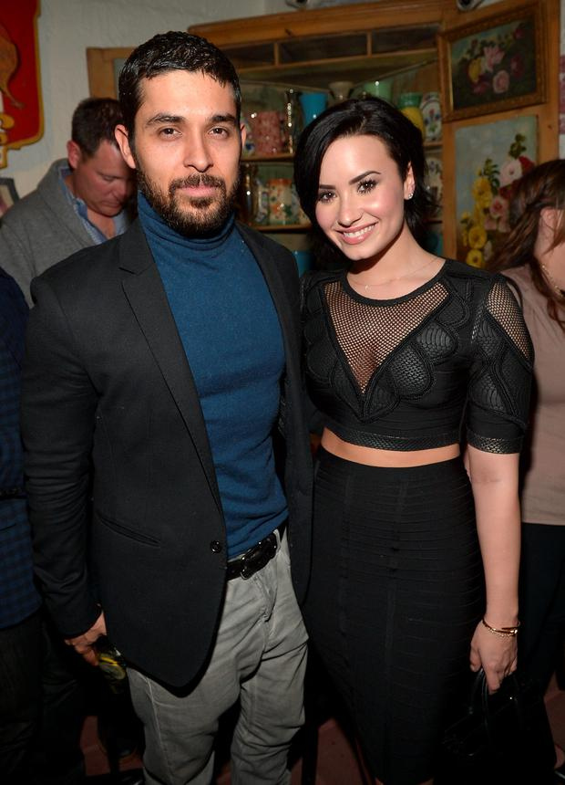 Wilmer Valderrama and Demi Lovato celebrate Nick Jonas' song