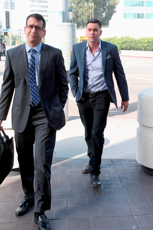 Mark Salling (R) arrives for a court appearance at United States Courthouse - Central District of California on June 3, 2016 in Los Angeles, California. Salling is turning himself in to federal authorities and is scheduled to be arraigned on two charges of child pornography. (Photo by Frederick M. Brown/Getty Images)