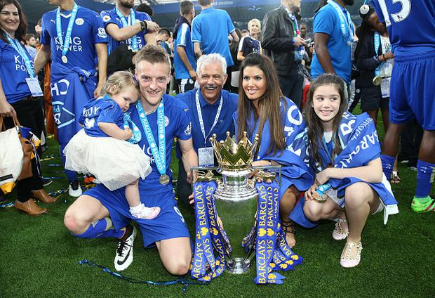 LEICESTER, ENGLAND - MAY 07 : Jamie Vardy of Leicester City celebrates with his fiancee Rebekah Nicholson and family with the Premier League trophy at the King Power Stadium on May 7th , 2016 in Leicester, United Kingdom. (Photo by Plumb Images/Leicester City FC via Getty Images)
