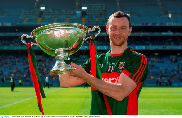Keith Higgins of Mayo with the cup