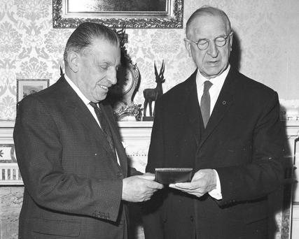 "INTO THE SWINGING SIXTIES: Sean Lemass, left, receiving his seal of office from then-president Eamon de Valera in June 1959. A new book claims that on Lemass's watch ""the age of auction politics arrived"". Photo: Independent Newspapers"