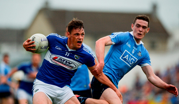 John O'Loughlin of Laois in action against Brian Fenton