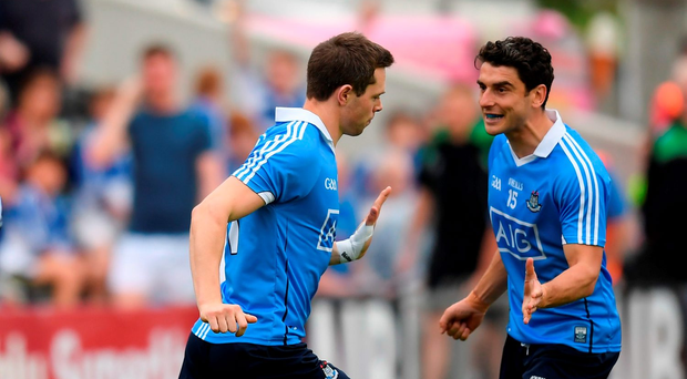 Bernard Brogan congratulates team-mate Dean Rock, who found the net after just 15 seconds for Dublin in their Leinster championship victory over Laois at Nowlan Park last night. Photo: Sportsfile