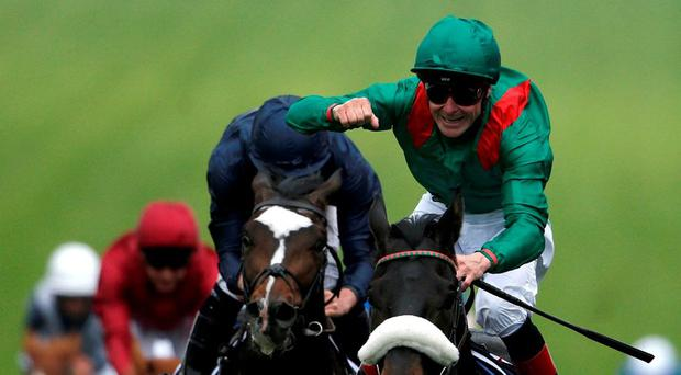 Pat Smullen celebrates after steering Harzand to Derby glory at Epsom. Photo: Alan Crowhurst/Getty Images