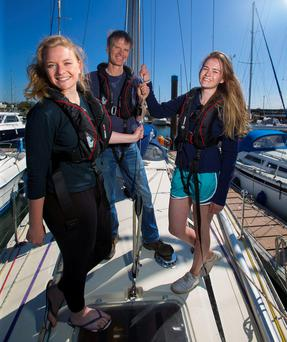 RACE IS ON: Keith Miller with his daughters, Alice and Hannah, on their boat Andante at Kilmore Quay. Photo: Patrick Browne