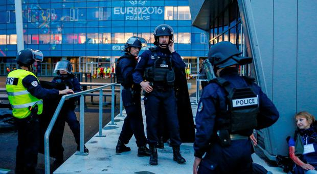 French Police forces take part in a mock attack drill outside the Grand Stade stadium (aka Parc Olympique Lyonnais or the Stade des Lumieres) in Decines, near Lyon, France, in preparation of security measures for the UEFA 2016 European Championship May 30, 2016. REUTERS/Robert Pratta
