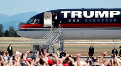 Republican U.S. presidential candidate Donald Trump arrives to a campaign rally in Redding, California. REUTERS/Stephen Lam