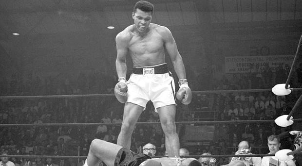 Muhammad Ali standing over a defeated Sonny Liston in their 1965 rematch. Photo: Bettmann/CORBIS