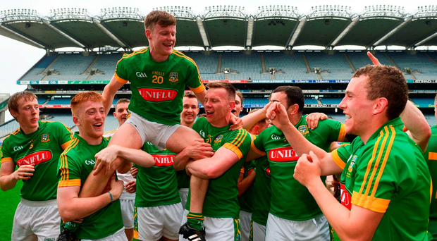 Seán Quigley of Meath is held aloft as his team-mates celebrate after the Christy Ring Cup Final between Antrim and Meath in Croke Park