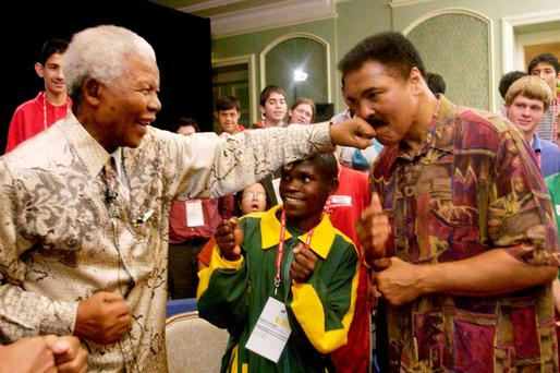 PACKING A PUNCH: Nelson Mandela lands a left on Muhammad Ali's chin in Dublin. Photo: Ray McManus