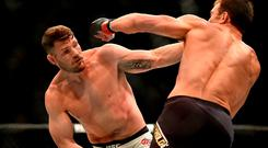 Michael Bisping, left, fights Luke Rockhold during a UFC 199 at the Forum in Inglewood