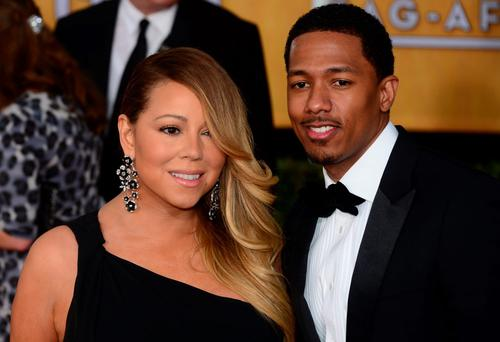 Singer Mariah Carey and Nick Cannon attend the 20th annual Screen Actors Guild (SAG) Awards on January 18, 2014