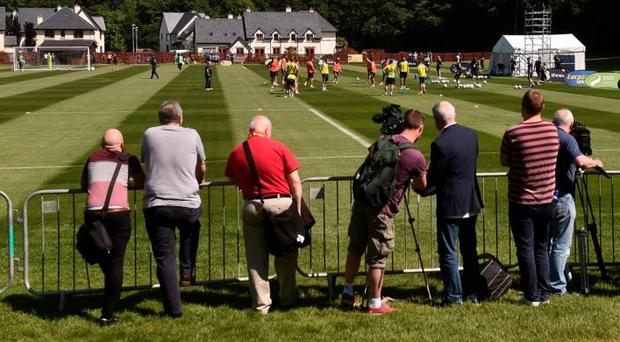 The Irish media watch a training session during the week